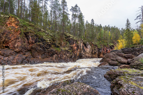 Red cliff, stone wall, forest, waterfall and wild river view in autumn Wallpaper Mural