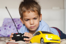 Little Boy And Toy Car