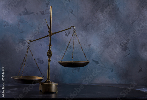 Fotografie, Obraz  Law antique scales on dark gray background with copy space