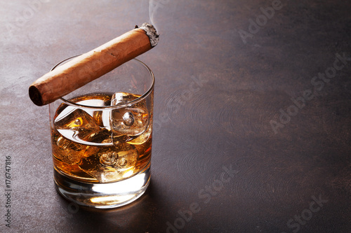 Whiskey with ice and cigar