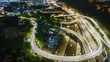 4k Time lapse of busy highway curve road at night, high level aerial view.