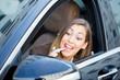 Beautiful woman putting on lipstick in car