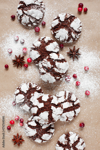 Fotografia, Obraz  Christmas crinkle chocolate cookies, cranberry and star anise on the craft paper
