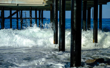 Waves Break About The Pier Pile