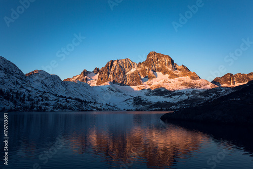 Sunrise on Banner Peak above Garnet Lake in the Ansel Adams wilderness after a f Canvas Print