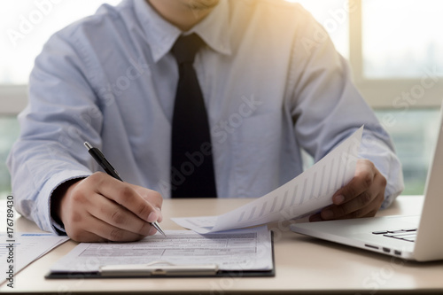 Fototapety, obrazy: Businessman working reading documents graph financial to job succes Analyze document plans