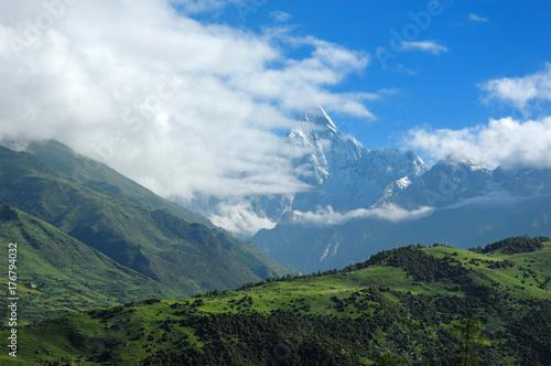 Fototapeta snow mountain peaks hiding in the white cloud in the morning obraz na płótnie