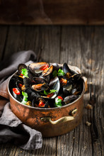 Tasty And Fresh Mussels With Coriander And Chili Peppers