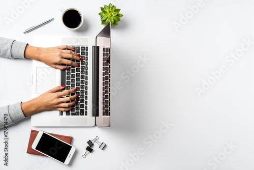 Female Hands Working On Modern Laptop Office Desktop On White
