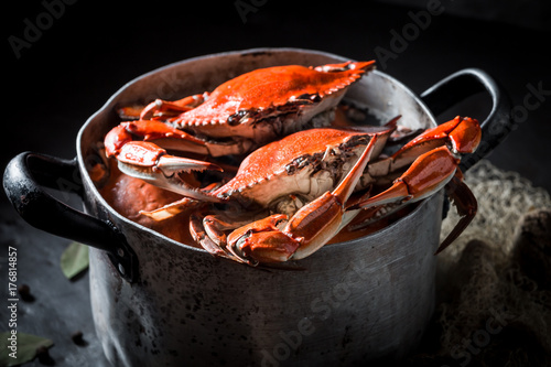 Poster Coquillage Ingredients for homemade crab in a old metal pot