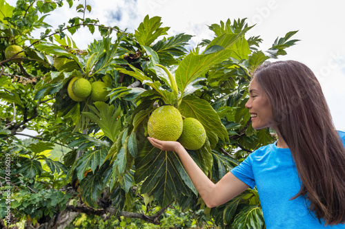 French Polynesia travel tourist girl with breadfruit