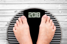 2018 Feet On A Weight Scale Is...