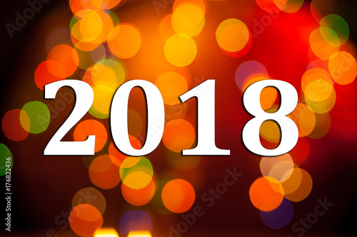 abstract new year background with 2018 inscription photo with text and orange bokeh