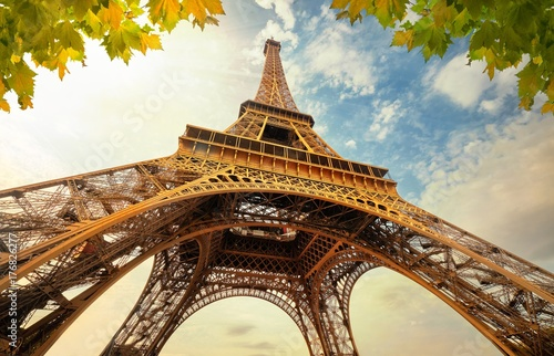Deurstickers Eiffeltoren Eiffel Tower in Paris France with Golden Light Rays.