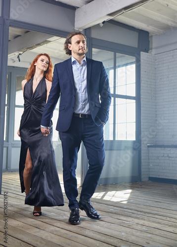stylish actors posing on a concrete background with pompous expression Tableau sur Toile