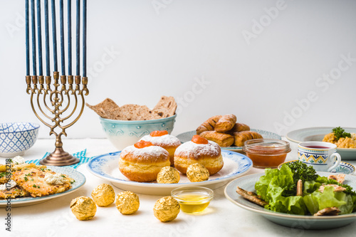 Jewish holiday Hanukkah, traditional feast side view Canvas Print