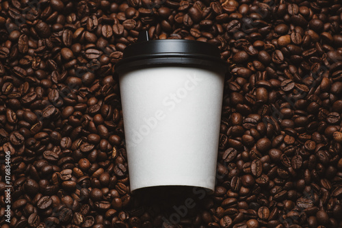 Wall Murals Cafe Mockup of coffee beans with white paper cup.