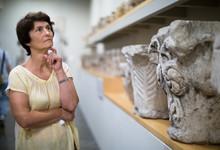 Female Evaluates The Exhibitio...