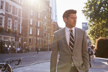 Businessman Walking To Work Al...
