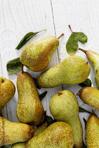 Abate fetel pears with leaves on white painted wood from above Canvas Print