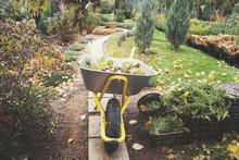 A Wheelbarrow Stands In A Coun...