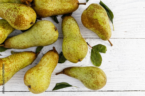 Abate fetel pears with leaves on white painted wood from above Wallpaper Mural