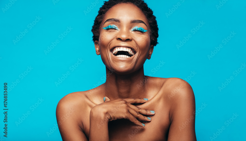 Fototapety, obrazy: Cheerful young woman with vibrant makeup