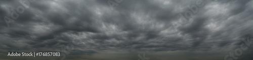 Fotografie, Obraz  Dark clouds before a thunderstorm, tornado, hurricane, in the vast sky