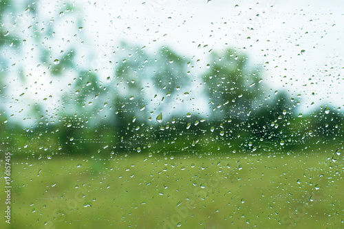 Rain drops on glass surface and outdoor background