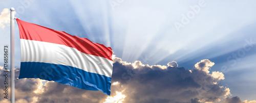 Fototapeta Netherlands flag on blue sky. 3d illustration obraz