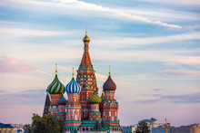 A Colorful Church, A Symbol Of The City And Country On The Background Of Houses And Sunset Clouds At Dusk And Nobody Around. St. Basil's Cathedral On Red Square, Moscow, Russia.