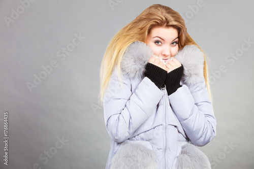Fotografie, Obraz  Woman wearing winter warm furry jacket