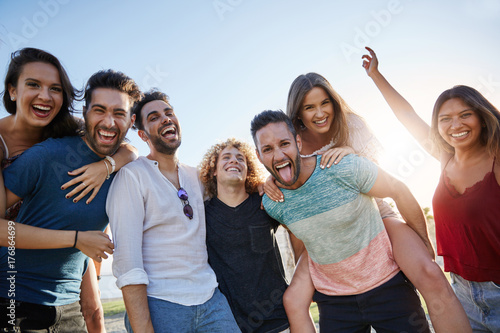 Fototapeta  Group of young happy people standing together outside