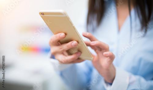 Fotografie, Obraz  Woman using a smartphone