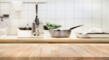 Wood Table Top On Blur Kitchen Room Background .For Montage Product Display Or  Key Visual Layout.