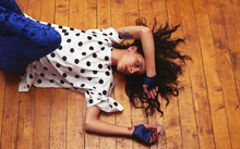 Young Woman Lying On The Floor...