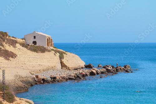 Fotografie, Obraz  Sea, rocky coast and church. Porto-Torres, Italy