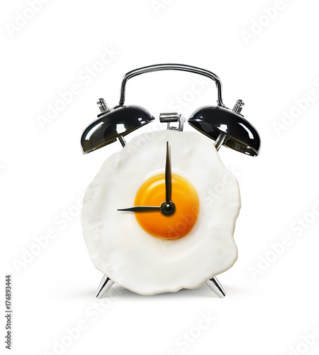 An alarm clock in the form of an egg isolated on a white background