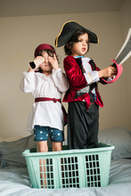 Two Young Pirate Boys In Their...