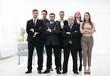 senior businessman and his confident business team
