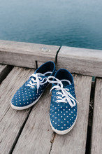 Dotty Blue Shoes On A Wooden Jetty