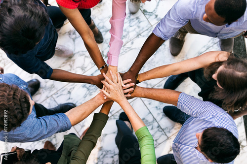 Fotografie, Obraz  Workspace: Team Of Diverse Workers Put Hands Together