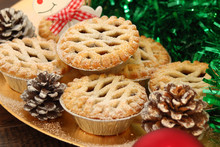 Christmas Mince Pies On A Gold Plate With Red Reindeer On A Wood Background