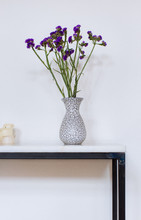 Purple Flowers In Vase Against...