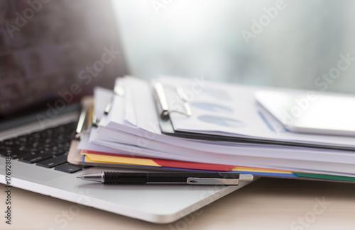 Fototapeta Businessman working reading documents graph financial to job succes Analyze document plans obraz