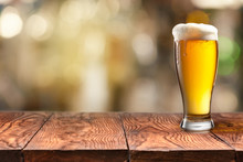 Glass Of Beer On Wooden Table ...