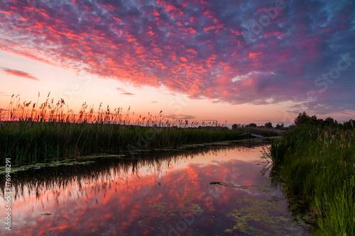 Foto op Aluminium Nachtblauw Reflection of a beautiful dawn sky in the river