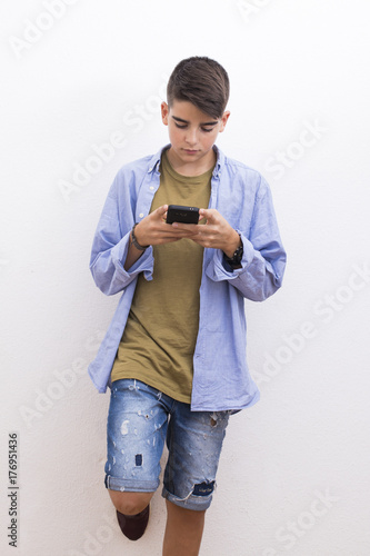 young preteen with mobile phone