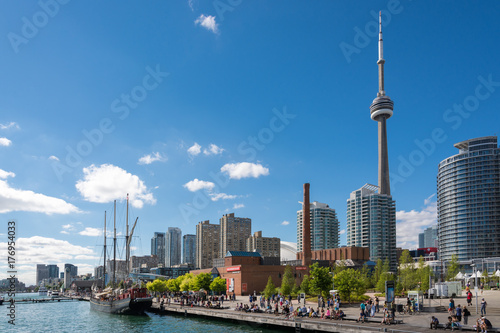People enjoying beautiful sunny afternoon near lake Ontario in Toronto