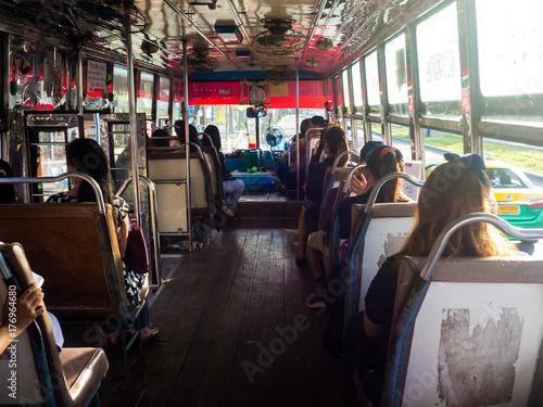 Tuinposter Inside a bus, public transportation in Bangkok, Thailand